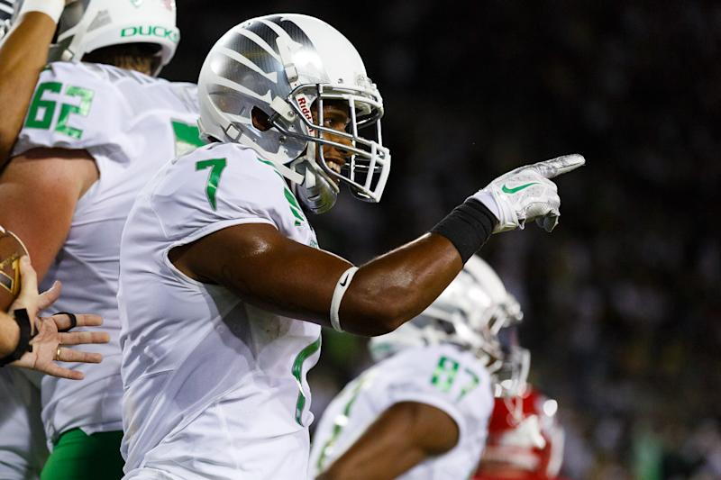 Oregon wide receiver Keanon Lowe (7) points to one of his teammates during the second quarter of an NCAA college football game in Eugene, Ore., Saturday, Aug. 30, 2014 (AP Photo/Ryan Kang)