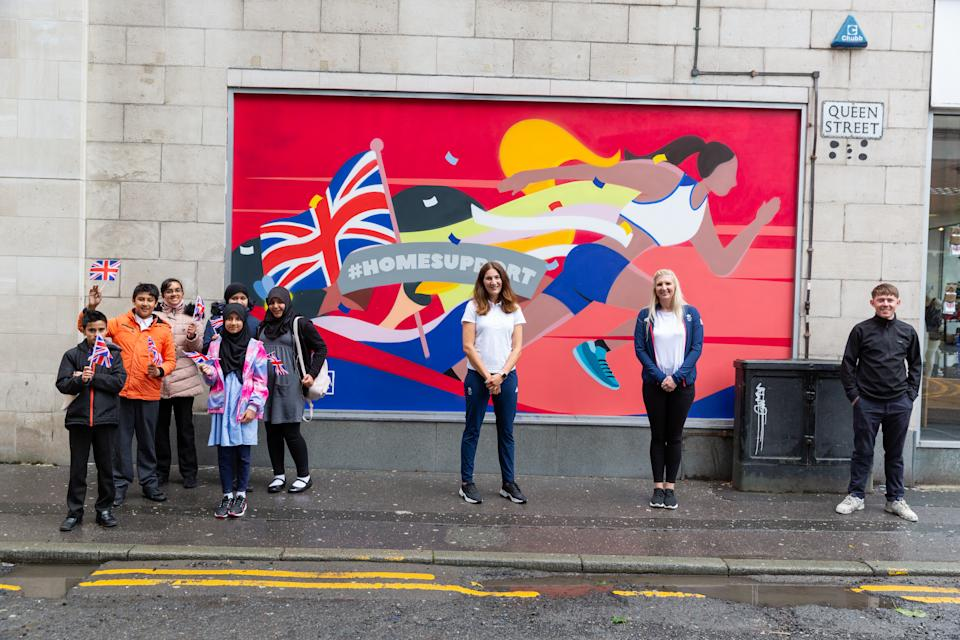 Local school children, Sarah Stevenson, Rebecca Adlington and artist Alex Altano at the unveiling of the mural in Manchester.
