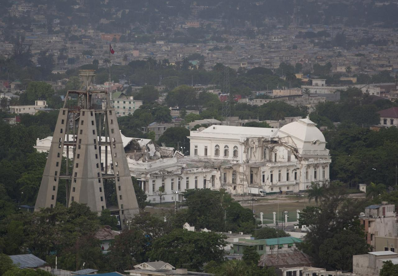"This Thursday, June 14, 2012 photo shows the earthquake damaged National Palace from the Fort Nationale neighborhood in Port-au-Prince, Haiti. Amid the horrors of Haiti's 2010 earthquake lay a promise of renewal. With the United States taking the lead, international donors pledged billions of dollars to help it ""build back better,"" breaking its cycle of dependency. Yet 2 1/2 years later, the fruits of an ambitious $1.8 billion U.S. reconstruction promise are hard to find. (AP Photo/Dieu Nalio Chery)"