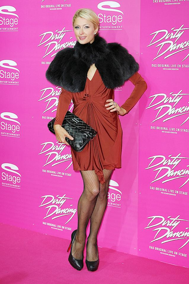 "Another fan of fur is socialite Paris Hilton, who looked quite ridiculous upon arriving at the German premiere of the ""Dirty Dancing"" musical in a monstrous shrug that we hope was faux. (10/19/11)"