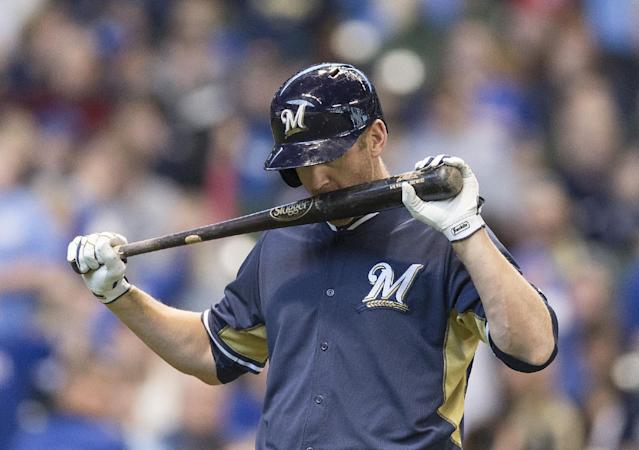 Milwaukee Brewers' Lyle Overbay reacts after being called out on strikes against the Kansas City Royals during the fifth inning of an exhibition baseball game Saturday, March 29, 2014, in Milwaukee. (AP Photo/Tom Lynn)