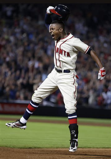 Atlanta Braves' B.J. Upton (2) celebrates after driving in the game-winning run with a base hit in the 10th inning of a baseball game against the Washington Nationals in Atlanta, Saturday, June 1, 2013. Atlanta won 3-2. (AP Photo/John Bazemore)