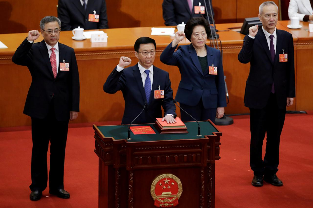 Newly elected Vice Premiers (L-R) Hu Chunhua, Han Zheng, Sun Chunlan and Liu He take an oath to the constitution at the seventh plenary session of the National People's Congress (NPC) at the Great Hall of the People in Beijing, China March 19, 2018.  REUTERS/Jason Lee     TPX IMAGES OF THE DAY
