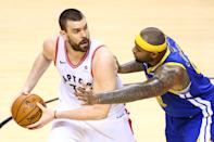 Marc Gasol #33 of the Toronto Raptors is defended by DeMarcus Cousins #0 of the Golden State Warriors in the second half during Game Five of the 2019 NBA Finals at Scotiabank Arena on June 10, 2019 in Toronto, Canada. (Photo by Vaughn Ridley/Getty Images)