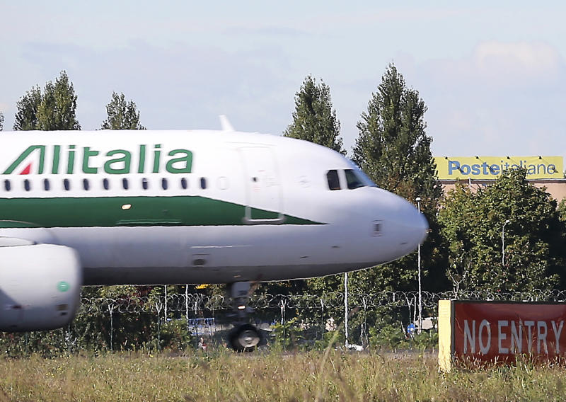 An Alitalia plane lands at Linate Airport, Milan, Italy, Friday, Oct. 11, 2013. The board of Alitalia met Friday to vote on a new rescue plan to inject 500 million euros (678 million dollars) for Italy's struggling flagship airline a day after the Italian government welcomed Italy's postal service, Poste Italiane SpA's help to re-capitalize Alitalia by injecting 75 million euros (101 million dollars). Alitalia's 62 years as a state-run company ended in bankruptcy in 2008. The present Alitalia began flying in 2009 as a new company owned by a group of Italian investors. Currently Air France is the largest shareholder with 25 percent. (AP Photo/Antonio Calanni)