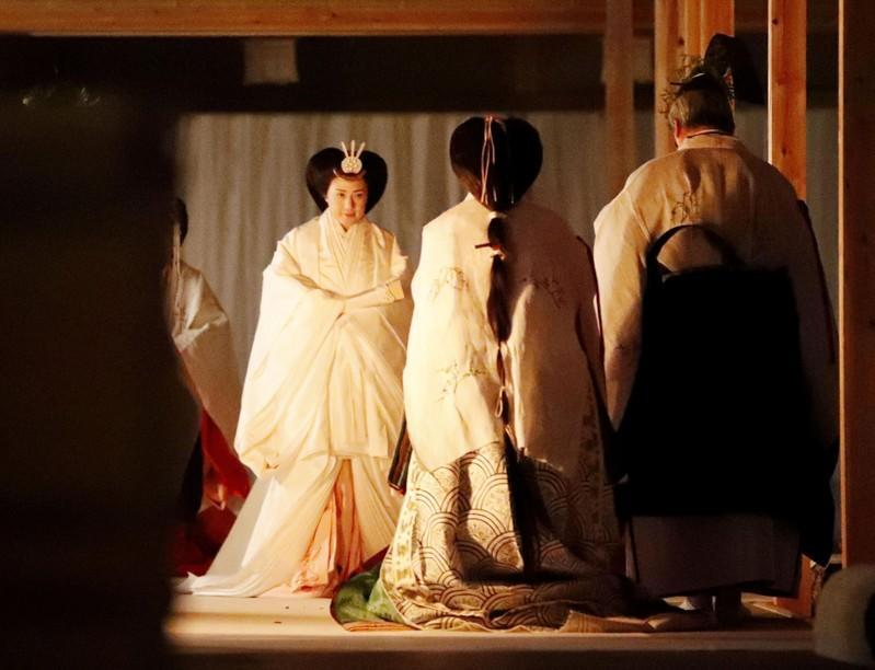 Japan's Empress Masako walks to Yukiden to attend 'Daijosai' at the Imperial Palace in Tokyo