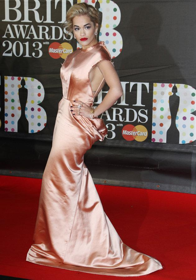 Celebs flashing side boob: Rita Ora wore this revealing dress to the BRITs 2013. Copyright [PA]