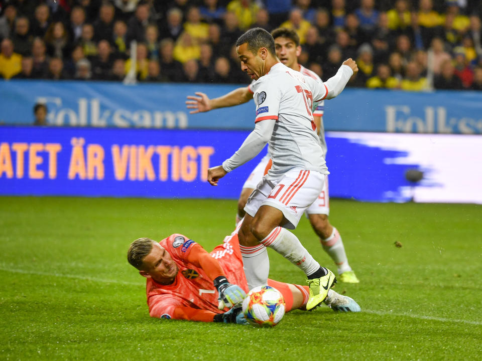 Spain's Thiago Alcantara tries to go for a goal but Sweden's goalkeeper Robin Olsen saves the attempt during their Euro 2020 Group F qualification soccer match between Sweden and Spain at Friends Arena in Solna, Stockholm, Sweden, on Tuesday Oct. 15, 2019.(Anders Wiklund / TT via AP)