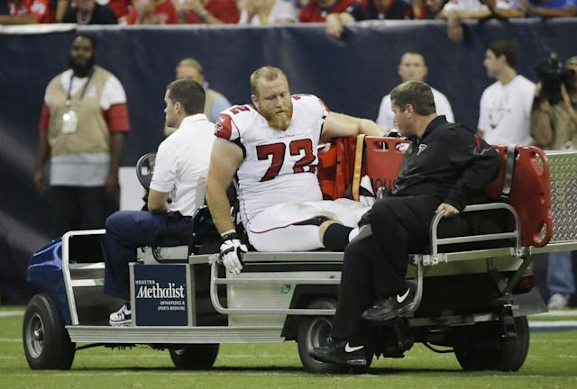 Atlanta Falcons' Sam Baker (72) leaves on a cart after he was injured during the second quarter of an NFL preseason football game against the Houston Texans, Saturday, Aug. 16, 2014, in Houston. (AP Photo/David J. Phillip)