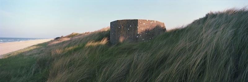 A former German defense bunker lies in Marram Grass along a stretch of coastline that was known as 'Utah Beach' during the June 6, 1944 D-Day Beach landings on April 30, 2019 in Audouville-la-Hubert, on the Normandy coast, France. (Photo: Dan Kitwood/Getty Images)
