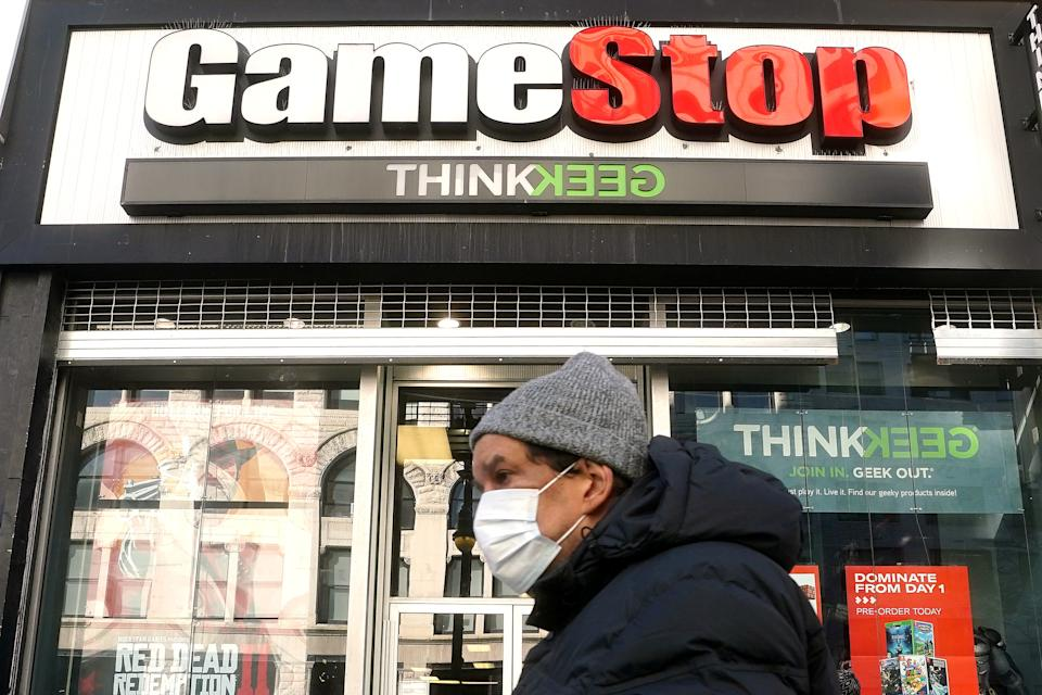 A person walks past a GameStop in the Manhattan borough of New York City, New York, U.S., January 29, 2021. REUTERS/Carlo Allegri