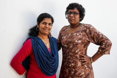 Kanaka Durga, 39 and Bindu Ammini, 40, the first women to enter Sabarimala temple which traditionally bans the entry of women of menstrual age, pose for a photo after an interview with Reuters at an undisclosed location on the outskirts of Kochi