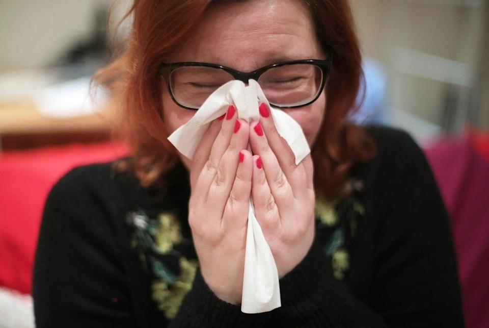 People are being urged not to grin and bear illness but stay away from the workplace if sick (Yui Mok/PA) (PA Archive)
