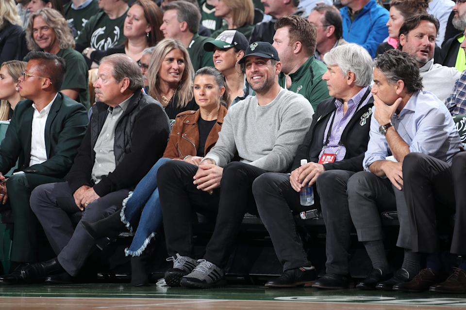 Danica Patrick and Aaron Rodgers attend Game Two of Round One of the 2019 NBA Playoffs between the Detroit Pistons and the Milwaukee Bucks on April 17, 2019 at the Fiserv Forum in Milwaukee, Wisconsin. (Photo by Nathaniel S. Butler/NBAE via Getty Images)