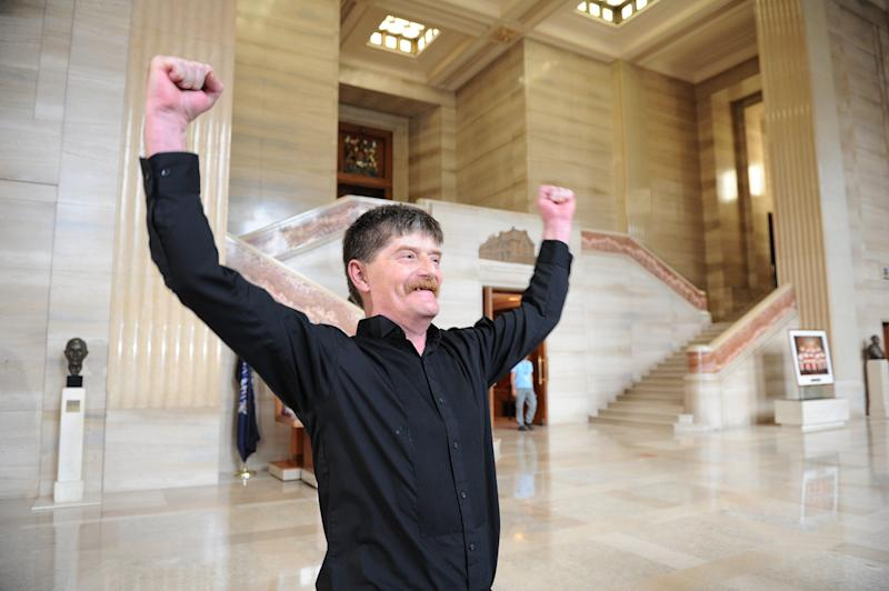 Plaintiff Dean Wilson, reacts to the ruling regarding Vancouver's supervised injection sites, in the lobby of the Supreme Court of Canada in Ottawa, Canada  on Friday, Sept.  30, 2011.   Canada's Supreme Court ruled Friday that North America's only legal drug injection facility can stay open.  North America's first injection facility was promoted by founders as a safe, humane space for drug abusers, but faced a court challenge from Canada's Conservative government which saw it as abetting drug abuse. (AP Photo/The Canadian Press, Sean Kilpatrick)