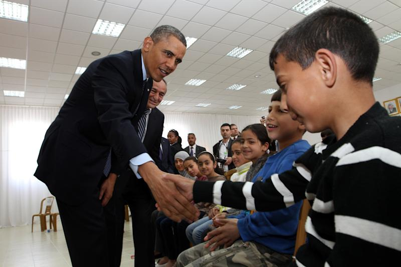 Obama shakes hands with Palestinian children during his visit to Al Bera Youth Center in the West Bank in March 2013. (Photo: Pool via Getty Images)