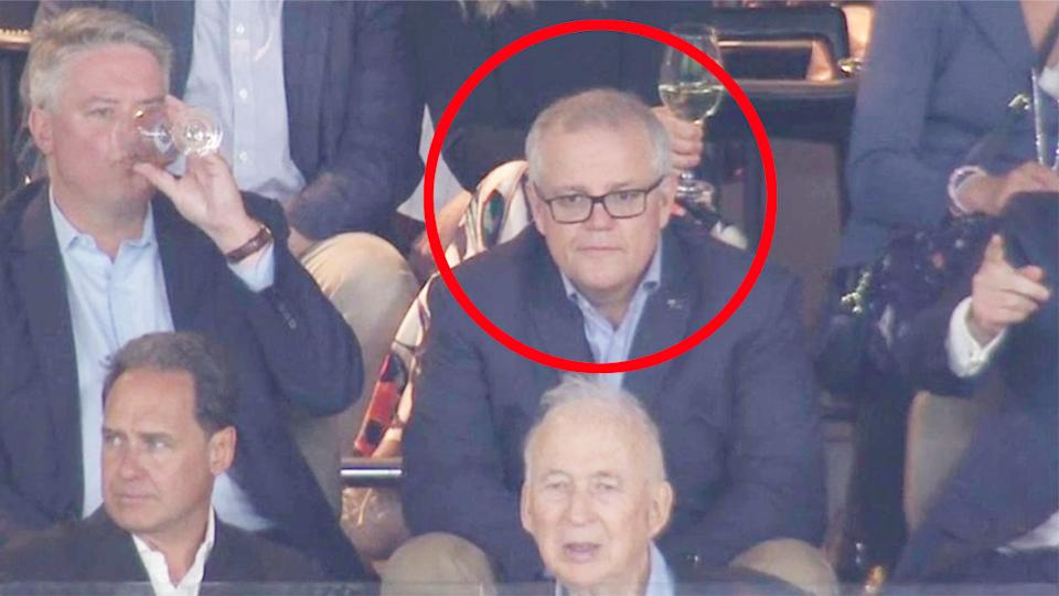 Pictured here, Scott Morrison watches West Coast's game from the stands at Optus Stadium.