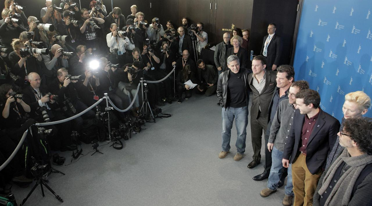 Director Joel Coen, actress Tilda Swinton, actor Alden Ehrenreich, director Ethan Coen, and the actors Josh Brolin, Channing Tatum, and George Clooney from right, pose for the photographers during a photo call for the film 'Hail Caesar' at the 2016 Berlinale Film Festival in Berlin, Germany, Thursday, Feb. 11, 2016. (AP Photo/Axel Schmidt)