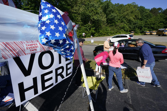 Convention workers collect ballots during a drive through GOP Convention vote in Chesterfield, Va., Saturday, May 8, 2021. (AP Photo/Steve Helber)