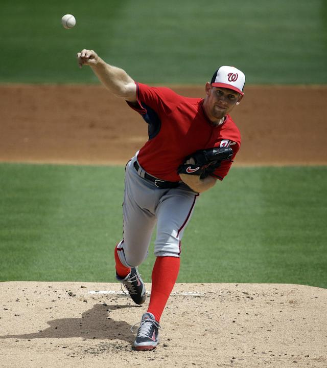 Washington Nationals starting pitcher Stephen Strasburg throws in the first inning of an exhibition spring training baseball game against the Miami Marlins, Saturday, March 15, 2014, in Jupiter, Fla. (AP Photo/David Goldman)