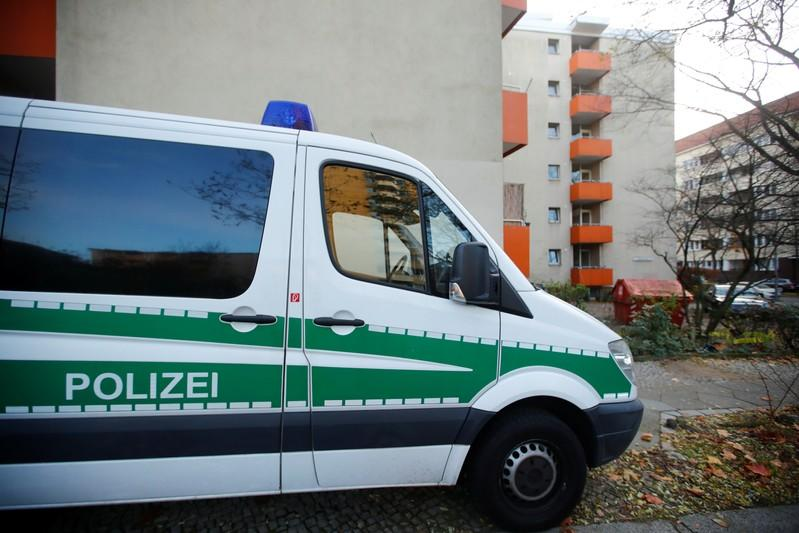 A police car is pictured outside the house of a Syrian man suspected of exchanging bomb building material that was arrested earlier today in Berlin