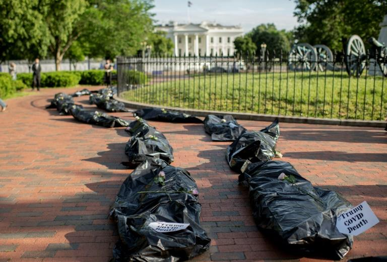 Mock body bags are seen outside the White House during a protest against President Donald Trump's handling of the cornavirus pandemic