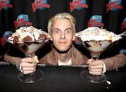 """<p>The """"Aaron's Party"""" singer double-fisted giant ice cream sundaes during a fan meet-and-greet at Planet Hollywood in Times Square. Too much sugar might account for his creepy expression… (Photo: Bruce Glikas/FilmMagic) </p>"""