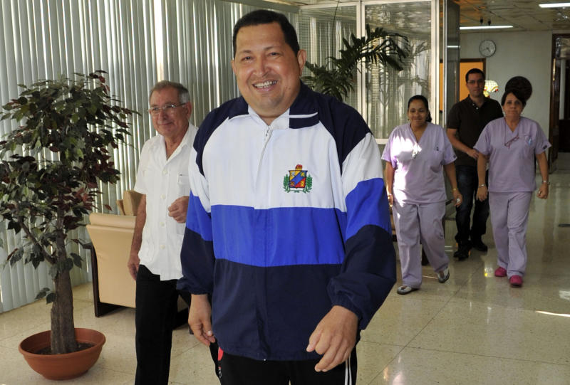 ALTERNATIVE CROP OF XLAT152 - In this photo released by Cubadebate and taken by Estudios Revolucion, Venezuela's President Hugo Chavez walks in the hospital in Havana, Cuba, Friday March 2, 2012. Chavez said Friday he's recovering quickly from tumor surgery in Cuba. Chavez flew to Cuba on Feb. 24 to have a growth removed in the same part of the pelvic region where a larger, malignant tumor was extracted last year. (AP Photo/Estudios Revolucion)