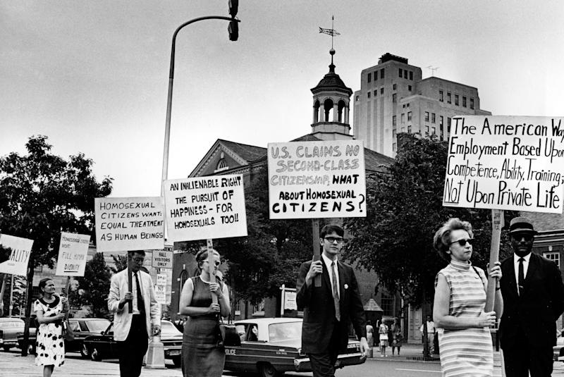 FILE - In this July 4, 1967 file photo Kay Tobin Lahusen, right, and other demonstrators carry signs calling for protection of homosexuals from discrimination as they march in a picket line in front of Independence Hall in Philadelphia. (AP Photo)
