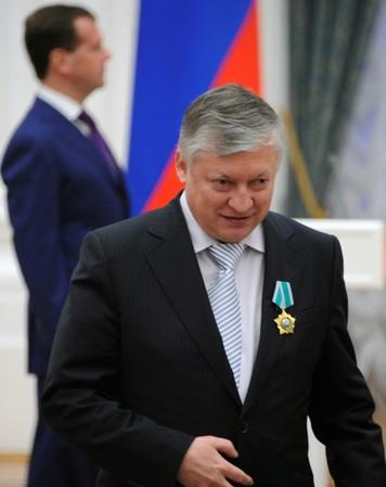FILE PHOTO: Former Russian chess world champion Karpov walks away from Russia's President Medvedev during an awarding ceremony in Moscow's Kremlin
