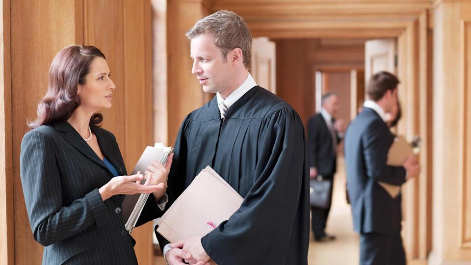 30-34 Years, 40-44 Years, 50-54 years, ATTORNEY, Asking, Carrying, Caucasian, Collaboration, Color Image, Consulting, Cooperation, Courthouse, Day, Explaining, Face To Face, Focus On Foreground, Full Length, Full Suit, Gesturing, Holding, Horizontal, Indoors, JUDICIAL, Judge, Justice, Law, Lawyer, Legal System, Listening, London, Mature Adult, Mature Men, Mature Women, Medium Group Of People, Mid Adult, Mid Adult Men, Mid Adult Women, Occupation, Paperwork, Photography, Robe, Side View, Standing, Talking, Teamwork, Togetherness, Truth, barrister, brunette, business attire, co-worker, folder, judgment, justness, legal, legal magistrate, legal profession, man, people, profession, solicitor, three quarter length, united kingdom, well dressed, woman, working together