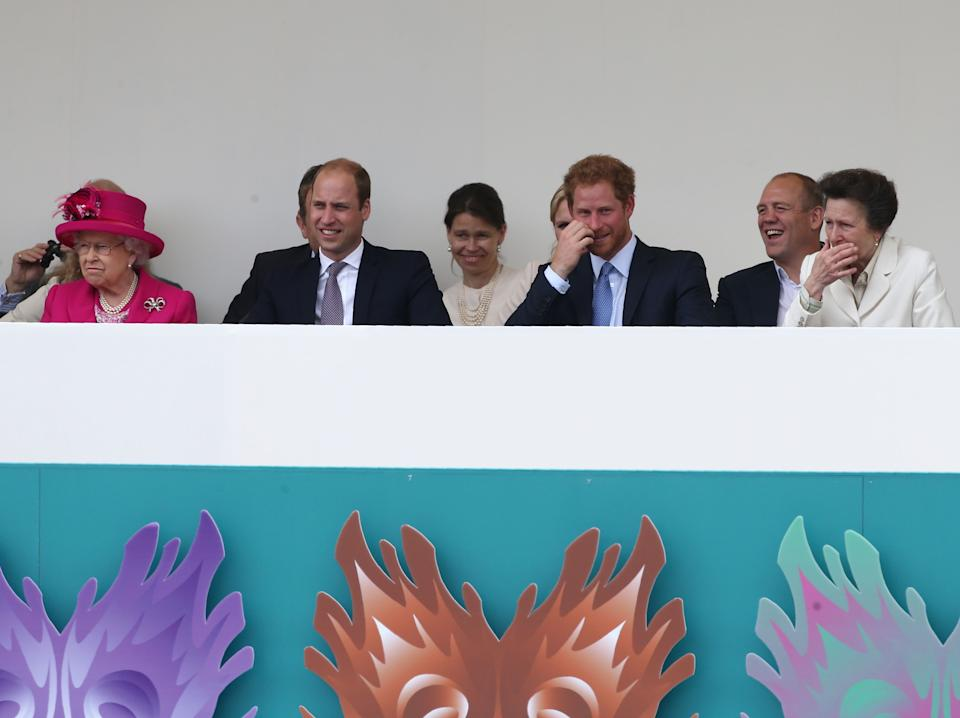 Britain's Prince Harry (3R), Mike Tindall (2R) and Britain's Princess Anne, Princess Royal (R) share a joke as Britain's Prince William, Duke of Cambridge (2L) and Britain's Queen Elizabeth II watch the Patron's Lunch, a special street party outside Buckingham Palace in London on June 12, 2016, as part of the three day celebrations for Queen Elizabeth II's official 90th birthday. - Up to 10,000 people are expected to attend the Patron's Lunch along with the monarch, her husband Prince Philip, Prince William and Prince Harry. (Photo by JUSTIN TALLIS / AFP) (Photo by JUSTIN TALLIS/AFP via Getty Images)