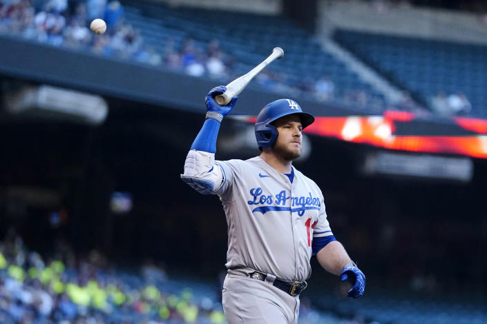Los Angeles Dodgers first baseman Max Muncy gets set to toss his bat after striking out against the Arizona Diamondbacks during the first inning of a baseball game Saturday, Sept. 25, 2021, in Phoenix. (AP Photo/Ross D. Franklin)