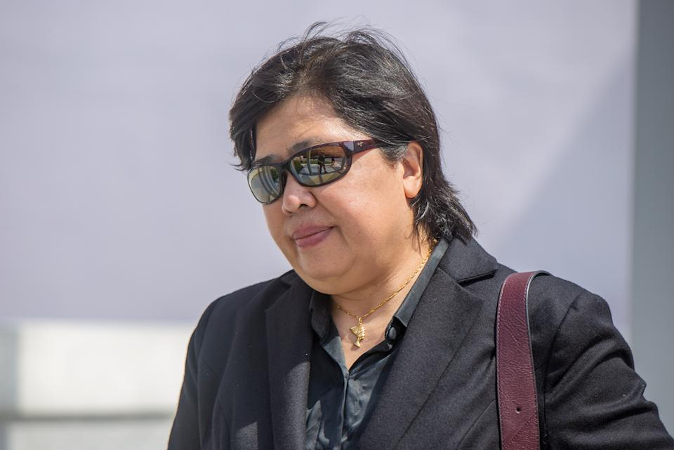 Phoon Chiu Yoke, 54, seen leaving the State Courts without her mask on 24 May 2021. (PHOTO: Dhany Osman / Yahoo News Singapore)