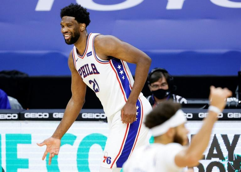 Philadelphia's Joel Embiid celebrates in the fourth quarter of the 76ers' NBA victory over the Washington Wizards