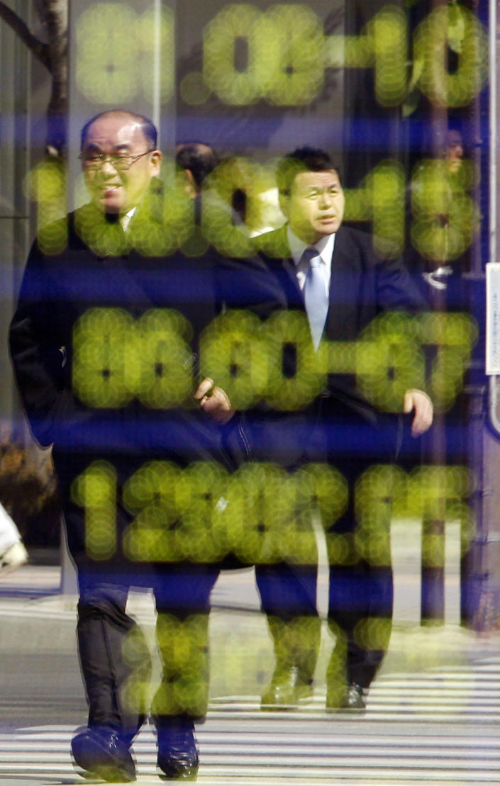 Pedestrians are reflected on an electric stock board of a securities firm in Tokyo, Monday, Feb. 27, 2012. Japan's Nikkei 225 index rose to 9,705.07 during morning trading. Asian stock markets were mostly higher Monday as investors looked ahead to data releases that analysts say will likely show the U.S. economy improving at a slow but steady clip. (AP Photo/Koji Sasahara)