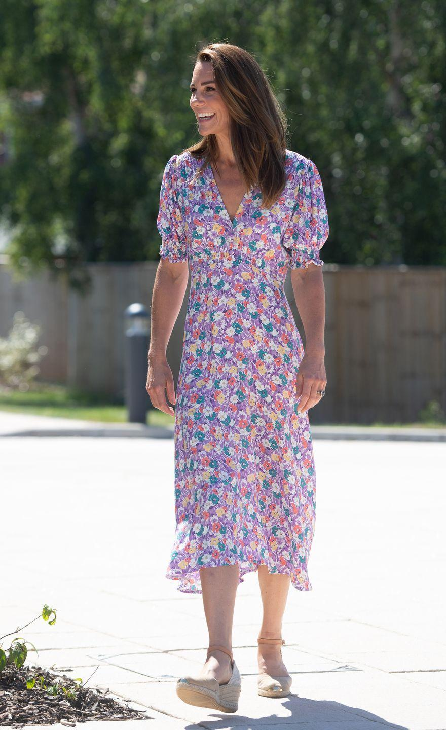 """<p>Duchess Kate looked summery and chic in a lavender, floral <a href=""""https://www.net-a-porter.com/en-us/shop/product/faithfull-the-brand/marie-louise-floral-print-crepe-midi-dress/1233974"""" rel=""""nofollow noopener"""" target=""""_blank"""" data-ylk=""""slk:midi dress"""" class=""""link rapid-noclick-resp"""">midi dress </a>by Faithfull the Brand and tan <a href=""""https://www.russellandbromley.co.uk/coco-nut/431707"""" rel=""""nofollow noopener"""" target=""""_blank"""" data-ylk=""""slk:Russell & Bromley espadrilles"""" class=""""link rapid-noclick-resp"""">Russell & Bromley espadrilles</a>. Kate wore this outfit to <a href=""""https://www.townandcountrymag.com/society/tradition/a32990521/kate-middleton-prince-louis-green-thumb-comment/"""" rel=""""nofollow noopener"""" target=""""_blank"""" data-ylk=""""slk:visit her patronage"""" class=""""link rapid-noclick-resp"""">visit her patronage</a>, the Nook in Framlingham Earl, Norfolk, one of three East Anglia's Children's Hospices.</p><p><a class=""""link rapid-noclick-resp"""" href=""""https://go.redirectingat.com?id=74968X1596630&url=https%3A%2F%2Fwww.saksfifthavenue.com%2Fsearch%2FEndecaSearch.jsp%3FbmText%3DSearchString%26N_Dim%3D0%26Ntk%3DEntire%2BSite%26Ntt%3DFaithfull%2Bthe%2BBrand&sref=https%3A%2F%2Fwww.redbookmag.com%2Flife%2Fg34824194%2Fkate-middleton-fashion%2F"""" rel=""""nofollow noopener"""" target=""""_blank"""" data-ylk=""""slk:Shop Faithfull the Brand"""">Shop Faithfull the Brand</a></p>"""