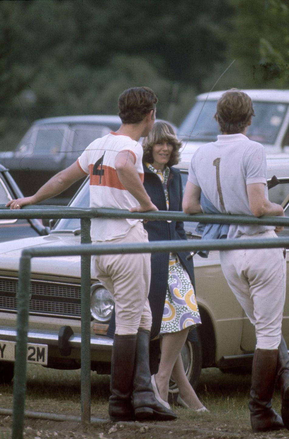 <p>With future husband Charles at a polo match. This was before they were both married to other people. </p>