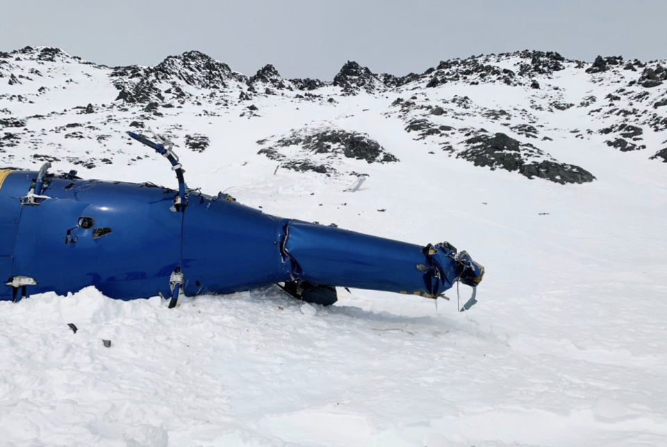 The wreckage of the helicopter seen in snow near the Knik Glacier in Alaska.