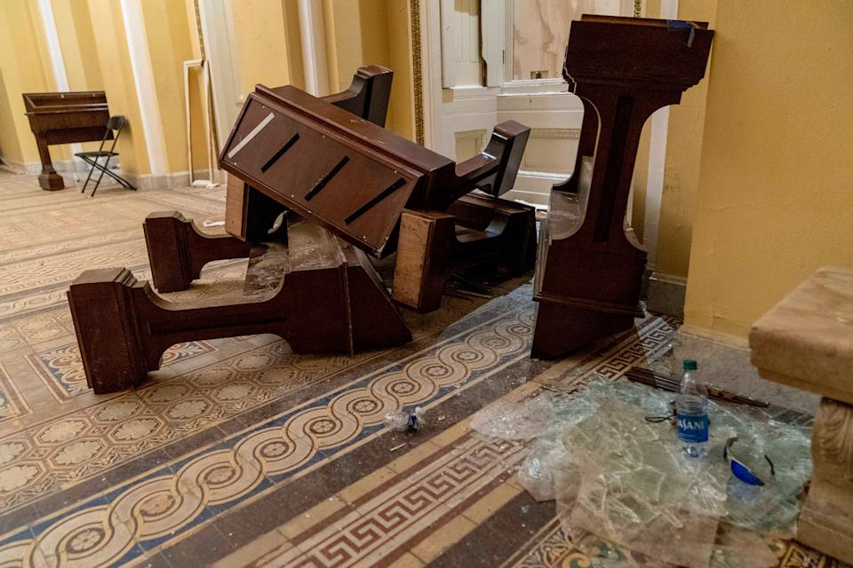Damage is visible in the hallways of the Capitol early Thursday after protesters stormed the building a day earlier. (Photo: ASSOCIATED PRESS)