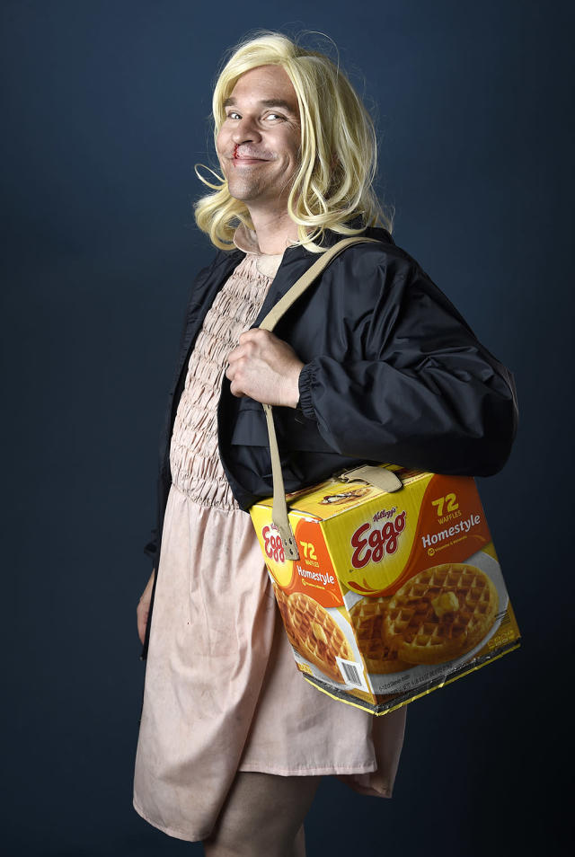 <p>Cosplay was in full force as this <i>Stranger Things</i> fan dressed as Eleven — with an Eggo box purse. <br><br>(Photo: Chris Pizzello/Invision/ AP) </p>