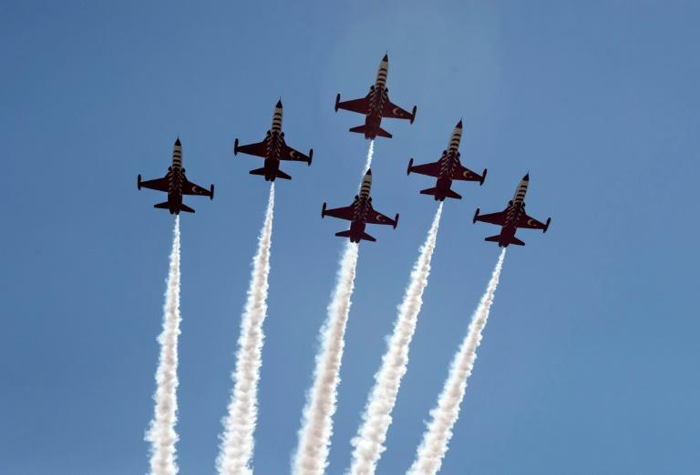 Turkish aircraft overfly a military parade in the northern part of Cyprus's divided capital Nicosia on July 20, 2021