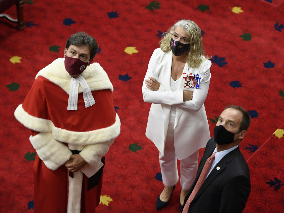 Chief Justice Richard Wagner, from left, Gov. Gen. Julie Payette and Sen. Marc Gold watch a livestream of the proceedings before the speech from the throne in the Senate chamber in Ottawa, Ontario, Wednesday, Sept. 23, 2020. (Justin Tang/The Canadian Press via AP)