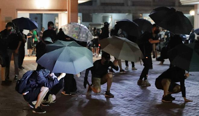 At least five protesters were subdued and taken away by police. Photo: Edmond So