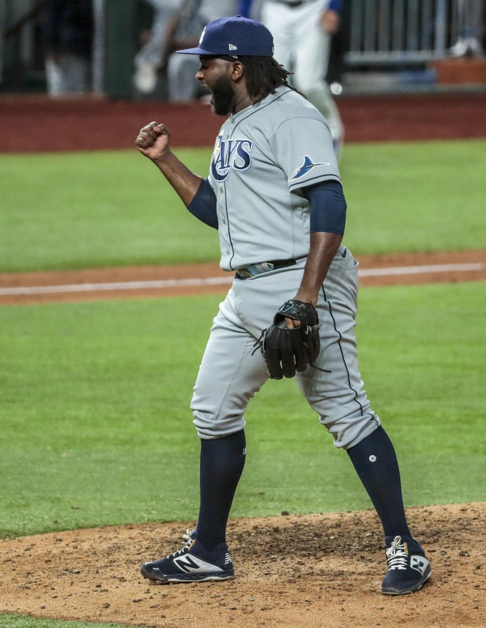 Tampa Bay Rays relief pitcher Diego Castillo celebrates after closing out a 6-4 win in Game 2 of the World Series.
