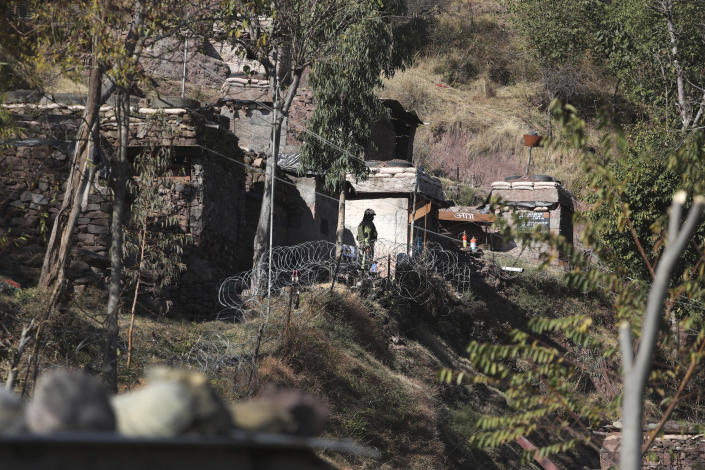 An Indian army soldier stands near a forward post at the Line of Control (LOC) that divides the region between the two nuclear-armed rivals of India and Pakistan, in Poonch, about 248 kilometers (155 miles) from Jammu, India, Wednesday, Dec. 16, 2020. Tens of thousands of soldiers from India and Pakistan are positioned along the two sides. The apparent calm is often broken by the boom of blazing guns, with each side accusing the other of initiating the firing. (AP Photo/Channi Anand)