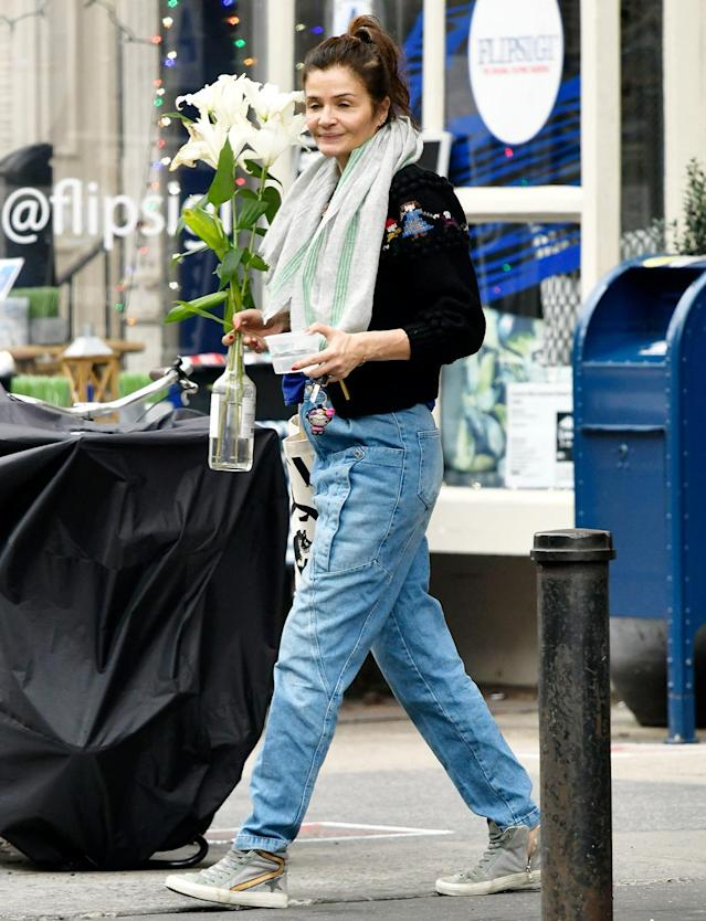 <p>Helena Christensen carries fresh-cut flowers on Thursday while out in N.Y.C.</p>