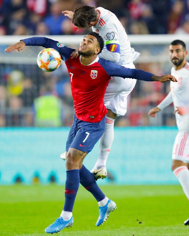 Norway's Joshua King left, fights for the ball against Spain's Sergio Ramos right during the UEFA Euro 2020 qualifying Group F soccer match between Norway - Spain at Ullevaal Stadium in Oslo, Norway on Saturday, Oct. 12, 2019. Photo: /NTB scanpix --- during the UEFA Euro 2020 qualifying Group F soccer match between Norway and Spain at Ullevaal Stadium in Oslo, Norway on Saturday, Oct. 12, 2019. (Tore Meek/NTB scanpix via AP)