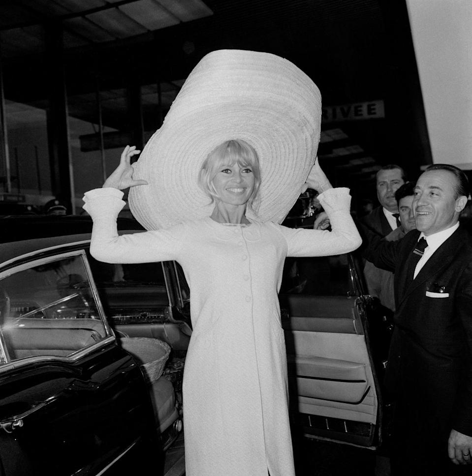<p><strong>Brigitte Bardot, 1965: </strong>Arriving at Paris' Orly airport after a trip to Mexico, Bardot's all smiles. But something tells us her seat mates were less than thrilled about her choice of hat?</p>
