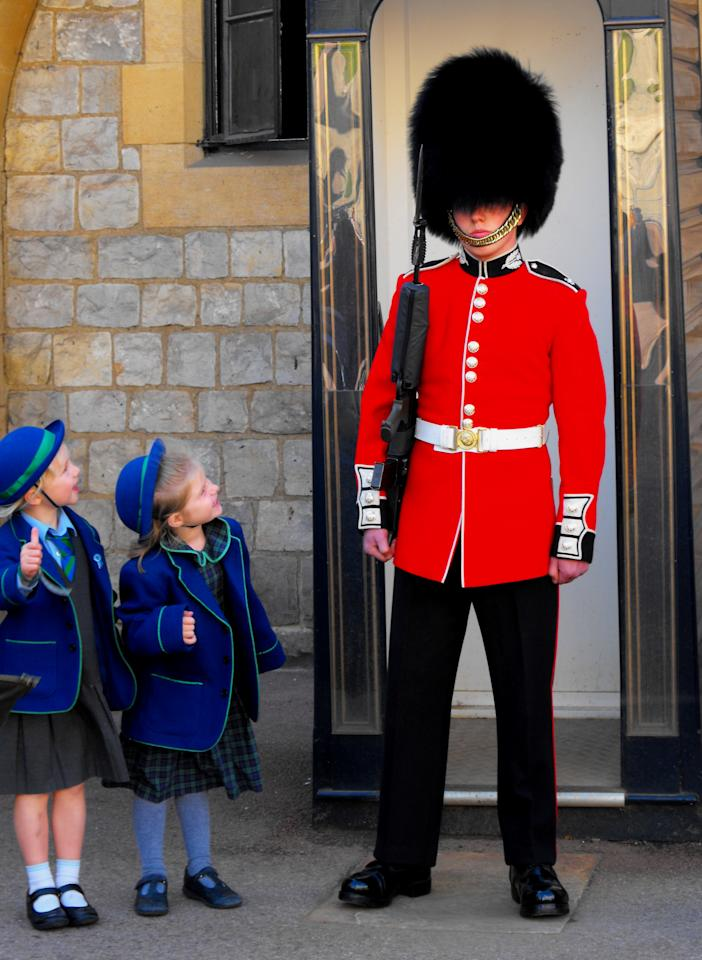 I ran into a group of schoolchildren visiting Windsor Castle in early October, and a few of the girls particularly enjoyed posing with the guard.  - Photograph by Robin Flynn , My Shot